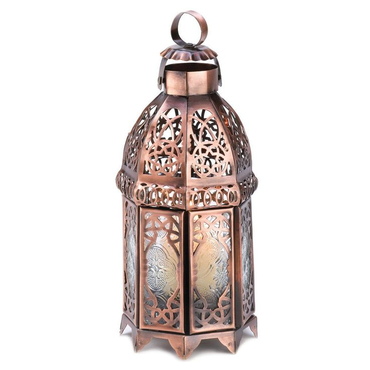 Intricate swirls of gleaming copper add luster to this dramatic candle lantern imparting the feel of a timeless treasure. Unique double-door design is sure to add a faraway flair to any surroundings!