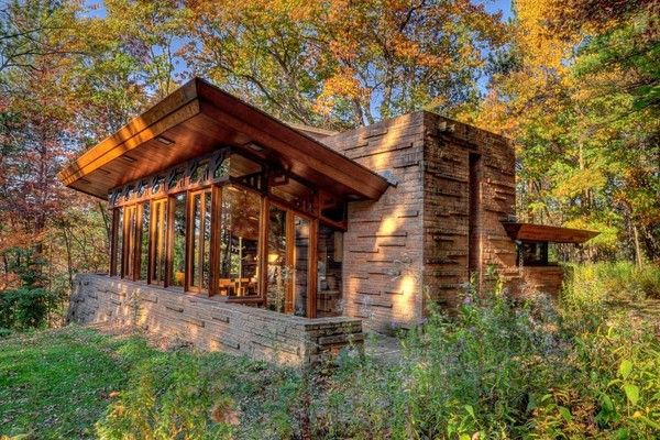 With a chimney that rises more than two stories, the Seth Peterson Cottage features an angled roof that frames views to the west and south.
