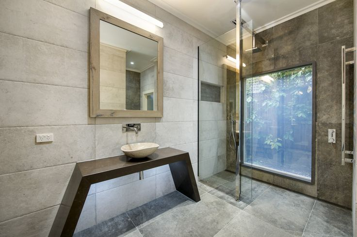 Eye Catching Bathroom with Swtichable Privacy Glass Window privately bringing in the outdoors indoors