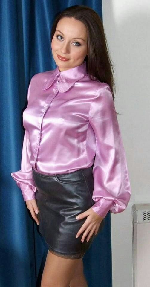Pink satin blouse and black leather skirt