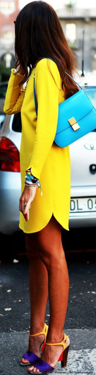 Cute yellow dress with turquoise handbag