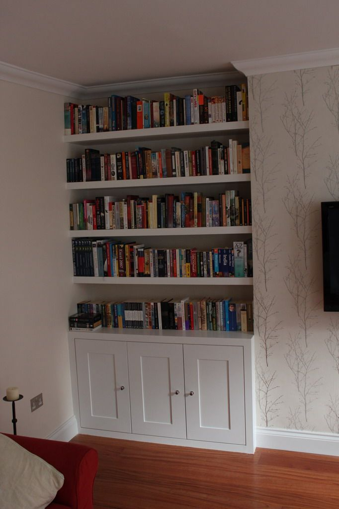 cupboard fitted in the alcove with floating shelves