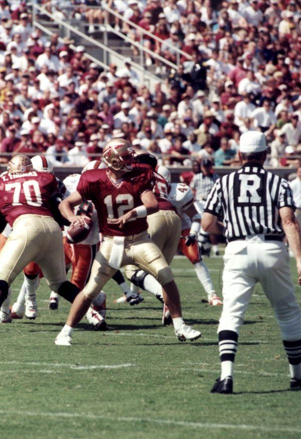 Florida Memory - FSU quarterback Thad Busby throwing against Miami at Doak Campbell Stadium - Tallahassee, Florida,1997