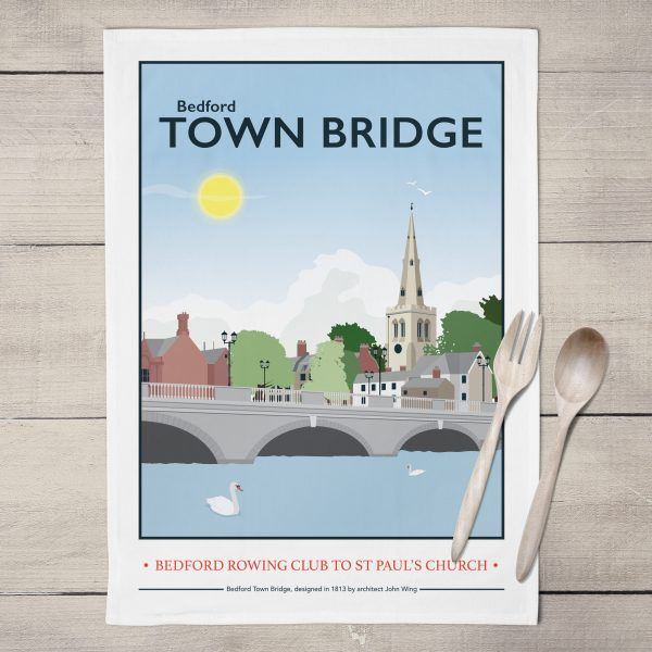 Bedford Town Bridge Tea Towel  £8.00  Bedford Town Bridge print is now available as a Tea Towel.  Designed by myself and professionally digitally printed and constructed in the UK on 100% Cotton Tea Towel complete with hanging loop. Tea Towel is packaged in branded packaging making it the perfect gift or treat for yourself! Tea Towel Dimensions: 45.5cm x 70cm. Wash care instructions: Wash Max 40 degrees.
