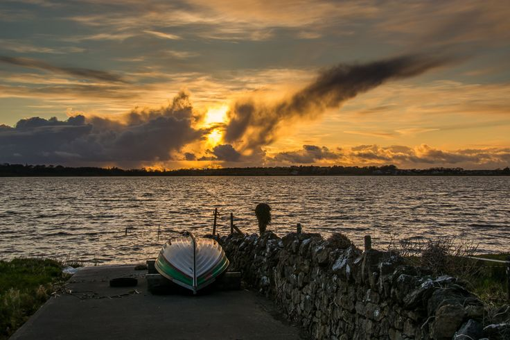 Sunset on #Loughrea #Lake in Galway.  Enjoyed the way the fading #light played on the boat.