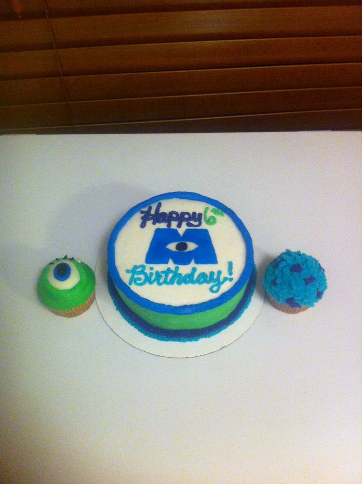 Monsters Inc. smash cake with Mike and Sully cupcakes.