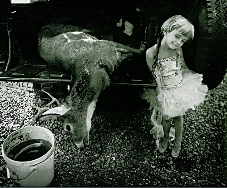 Sally Mann, Jessie and the Deer (1984). This photograph has a very unsettling vibe due to the juxtaposition between the smiling young girl and the slaughtered deer.