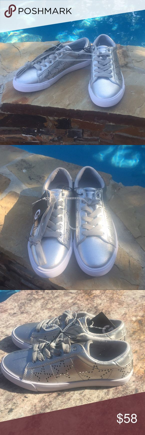 NWT Guess Shoes Adorable casual new shoes! They have a class tennis shoe style with modern star cut out designs. Silver with white soles. Guess Shoes Sneakers