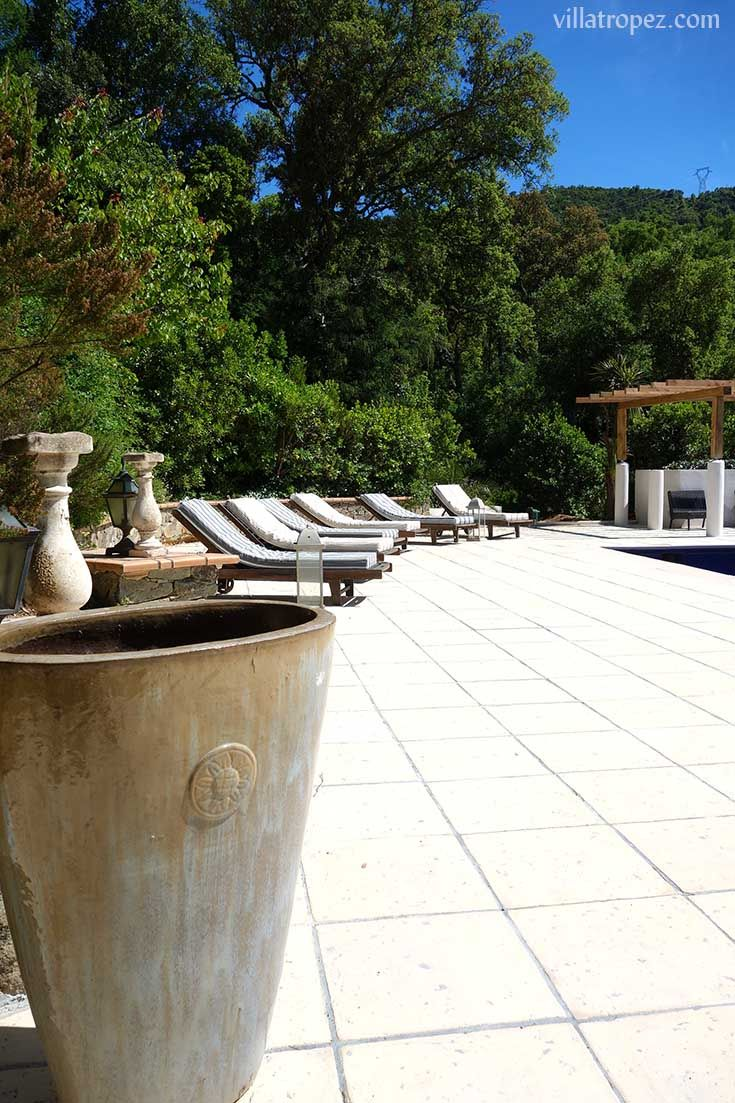 Stone paved sunlounger terraces of a private luxury rental villa, in true St Tropez beachclub style.  www.villatropez.com