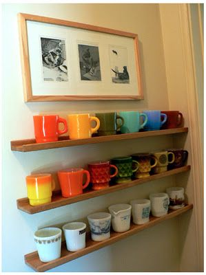 Coffee mug collection as an eye catching display. This IKEA Stripa shelving has been discontinued, but the Ribba picture ledge should serve the same purpose.