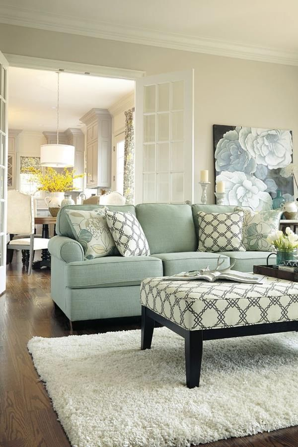 Light #blue decorWe loved the patterned throw pillows and the floral artwork.