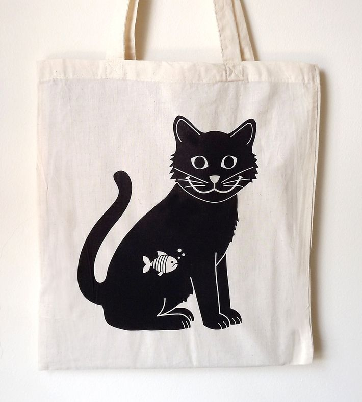 A fun handprinted tote bag design that is the purrfect gift for any cat lover. This tote bag is handprinted, 100% cotton and ethically produced. It roughly measures 42 x 38 cm and can be carried by hand or over the shoulder.    You can buy this tote bag at www.artrebels.com #artrebels #totebag #art