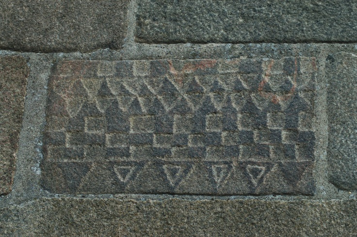 Chessboard pattern on Vivild Church. Quiet special with the triangles. Maybe this ashlar contains the explanation to the mystery of the chessboard figure. The equilateral triangle symbolises Trinity. The squares could therefore easily be interpreted as the checkered marble floor in Heaven.