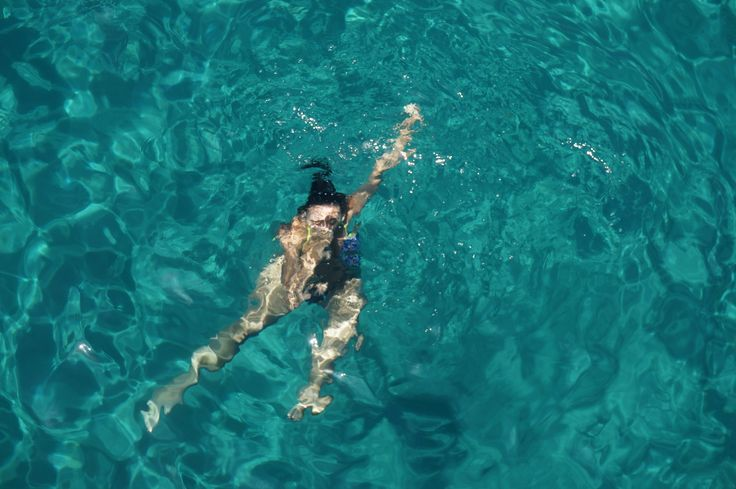 #Girl #swimming in #Mediterranean #Sea next to #Afantou  #Rhodes #Island #Greece