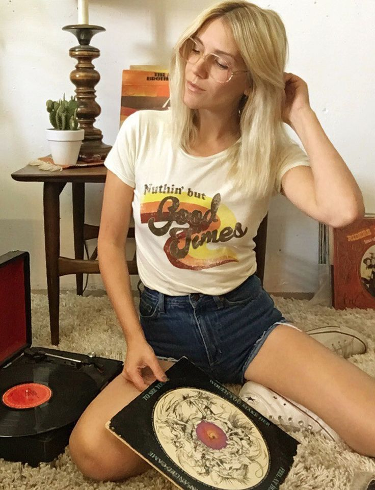 We're all about good times and good vibes with our Nuthin' but Good Times tee. Printed on super soft women's, fitted cream tees. 70's inspired print with vintage style distressing. We suggest sizing u