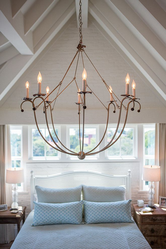 Beach House with Airy Coastal Interiors: This pendant really works in this light, airy space.