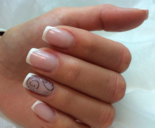 """Delicate and discreet transparent French with a perfect """"smile"""" is a great variant for the office, where there is a strict corporate dress code. Nails look perfectly natural, as if they did not have any cover. And only a thin silver """"squiggle"""" on the ring finger shows some freethinking."""