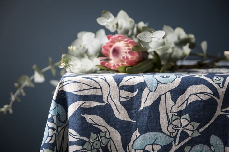 Still life with Protea with Utopia Goods. Beautiful indigo blue Mallee Gum linen tablecloth. Available in tableware, soft furnishings and upholstery fabrics.