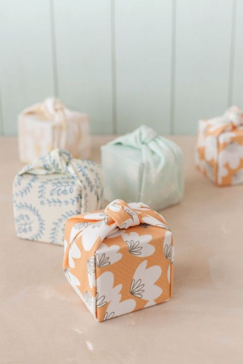 DIY Knotted Fabric Gift Wrap Tutorial from Julep. This tutorial only requires 2 cuts to create this neatly folded and wrapped gift box. This could be a good fabric stash buster and lovely wrapping for gifts given or products sold.