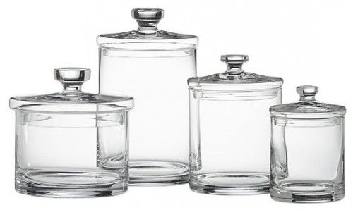 Crate barrell has this set of 4 glass canisters reminiscent of the old apothecary jars for Clear bathroom containers