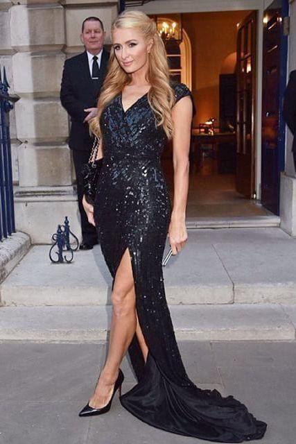 Paris Hilton wearing Chanel Jumbo Classic Flap Bag Black Patent ...