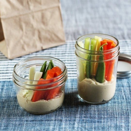 Chop celery and carrots into sticks, and create little hummus and veggie snack jars. | 17 Tricks To Help You Eat Healthy Without Even Trying