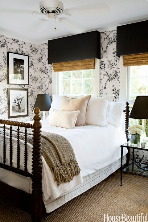 """Ralph Lauren Home's Ashfield Floral wallpaper turns a small guest room in a Hollywood Hills farmhouse into a romantic retreat. """"I think the pattern in these bedrooms come right off the wall and gives the room so much texture – they wrap you up and envelope you,"""" designer and owner Tobi Tobin says."""