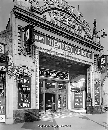 Finsbury Park Cinema 1923. An exterior view of the entrance to Finsbury Park Cinema advertising a varied programme, including a film of the heavyweight boxing bout between Jack Dempsey and Luis Angel Firpo fought on 14th September 1923. Photographed by Harry Bedford Lemere in October 1923.