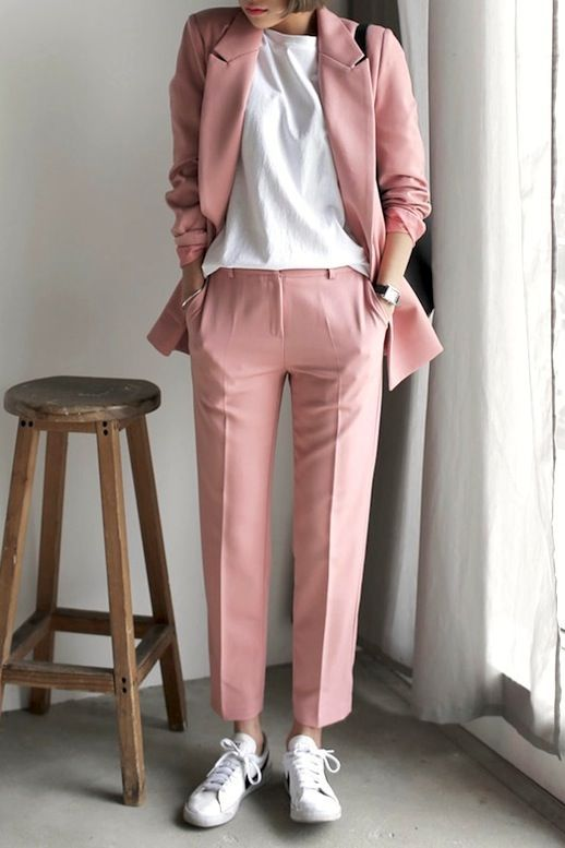Photos via: Dahong Instantly give your favorite pant suit a sporty-cool update by wearing it with a classic white tee, a simple tote bag and casual white sneakers. Get the look: + Topshop Premium Suit