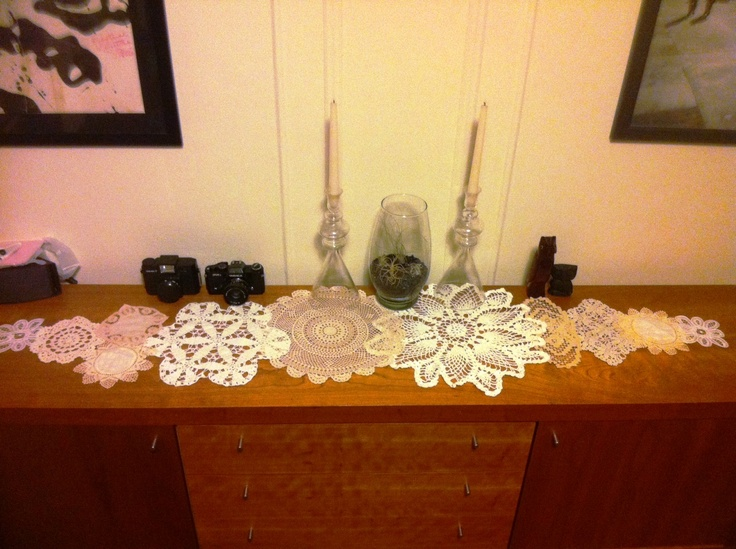 Used vintage thrift shop doilies to create a table runner.