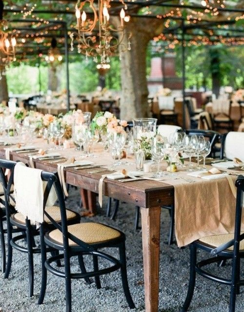 great tables with awesome black chairs in an inspiring setting.  great tree-shaded open air venue