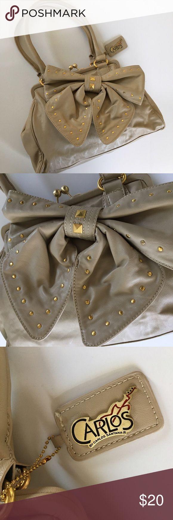 Studded Bow Carlos Santana Handbag Carlos by Carlos Santana handbag. Big bow with gold stud detailing. Gold hardware on tan/grey faux leather. Perfect condition. Like new. NEVER WORN. Carlos Santana Bags Shoulder Bags