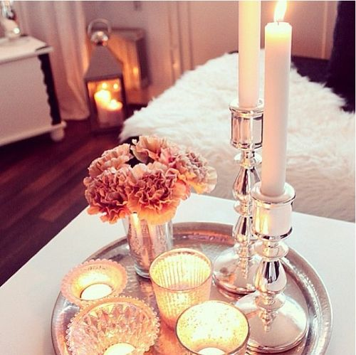I definitely wants lots of candles flowers and metallics in my apartment.  I dunno if i like gold or silver better.  maybe i could do both?