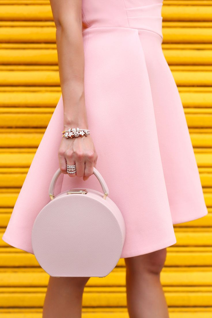 We can't help but love the way @rclayton makes pink pop from head-to-toe. Recreate her look with elegant touches of PANDORA rose charms and bracelets crafted in our unique blush-hued metal blend