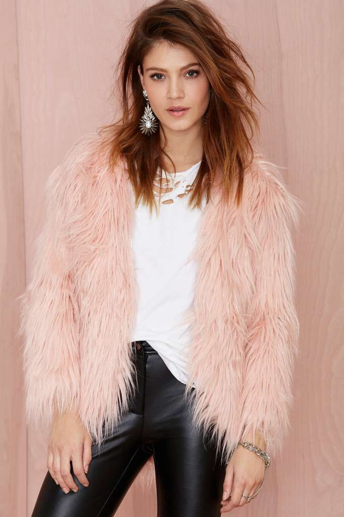 Unbelievably soft pink faux fur jacket featuring an open front and silky pink lining.