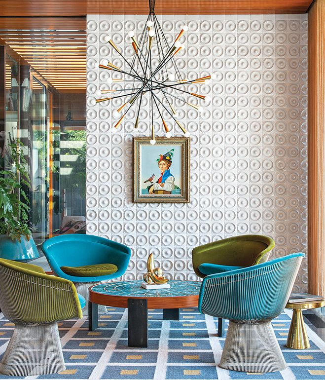 """There's no right answer except to play and experiment,"" Adler says about furnishing the interior. He reupholstered vintage Warren Platner chairs with velvet from Kravet. Drawings by Eva Hesse inspired the custom ceramic wall tile. Adler also created the coffee table, rug, planters, and gold stool. The pendant lamp is from Rewire in Los Angeles and the artwork is by Jean-Pierre Clément.   Photo by Christian Schaulin."