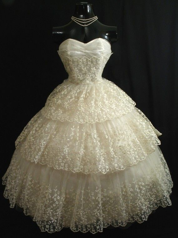 An original 1950s strapless gown in cascading layers of ivory chantilly lace and tulle - from VintageVortex on Etsy.