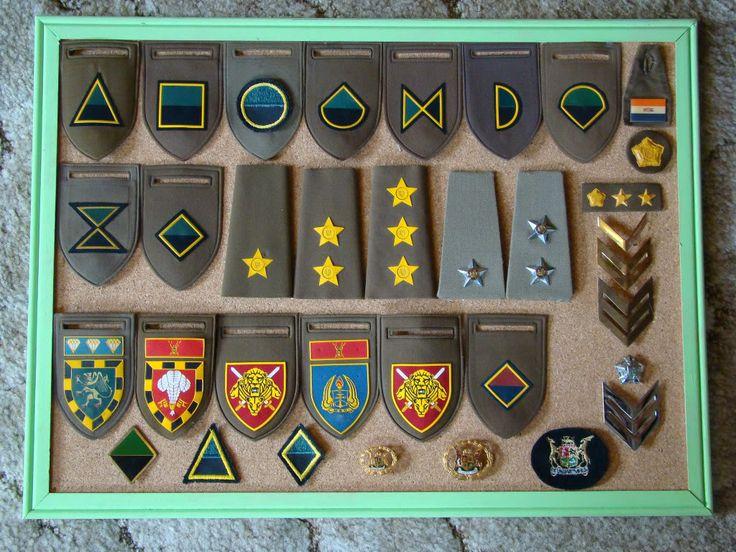 "SADF rank shoulderboards, Company ""tupperware"" badges, Unit ""tupperware"" badges, ect."