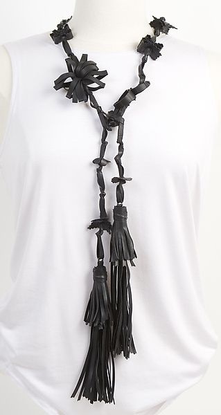 """Genevieve Tassel Necklace/Belt can be worn in many ways-. a necklace, belt, scarf, or lasso. Use your imagination with this 60'', eco-friendly, lightweight, whimsical creation made of recycled bicycle inner tubes. A thorough washing process rids them of """"bike tube"""" odor. Excellent jewelry for travelers- packs easily. By Kathleen Nowak Tucci."""