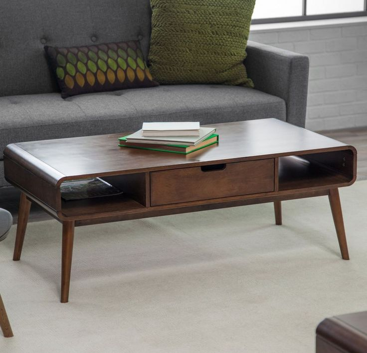 This sleek coffee table has it all, a modern style with a Mid-Century elegance. The table has plenty of space on top plus tuck away magazines and remote controls. Rounded edges and long, tapering legs