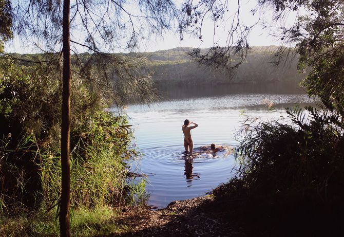 As you glide in, the water changes from black to a deep brown, coloured by the native tea trees framing the lake, giving their healing elixir to the water.