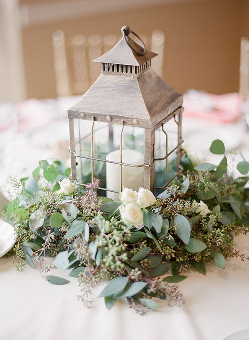 Cluster greens around lanterns for non-dinner table decor (buffets, bar tables, guest book table, etc.)