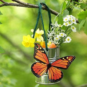 Butterfly Feeder  Butterflies can be a beautiful addition to your yard or garden. Fill a jar or tin can with some colorful flowers--the brighter the better because butterflies are attracted to color--and add a little sponge or cotton ball soaked in sugar water. Soon you'll see butterflies flitting all over your garden. Add an artificial butterfly to the can for the full effect.