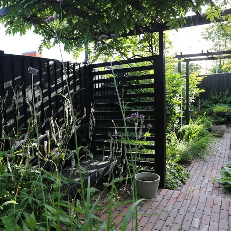 A Horizontal Black Wooden Screen And Pergolas Divide This Garden Into  U0027roomsu0027 By @