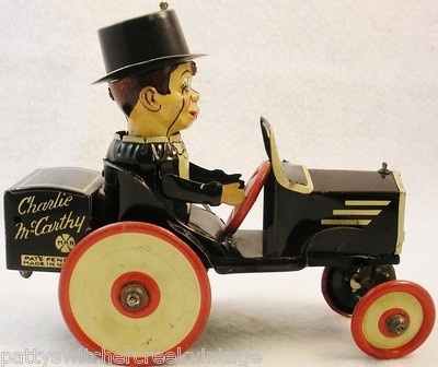 Antique Charlie McCarthy benzine buggy red wheels tin wind up toy car