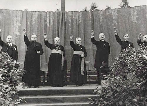 Catholic priests give the Nazi salute near the Vilna ghetto in occupied Poland.  It should be noted that the priests gave the salute voluntarily and with enthusiasm.