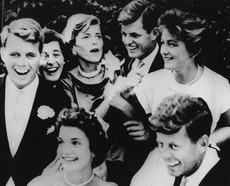 Kennedy siblings at the wedding reception of Jacqueline Bouvier to John F. Kennedy, Hammersmith Farm, Newport, RI, September 12, 1953. Clockwise from left: Robert F. Kennedy, Patricia Kennedy, Eunice Kennedy Shriver, Edward M. Kennedy, Jean Kennedy, John F. Kennedy, Jacqueline Bouvier Kennedy. Photograph by Toni Frissell in the John F. Kennedy Presidential Library and Museum, Boston.