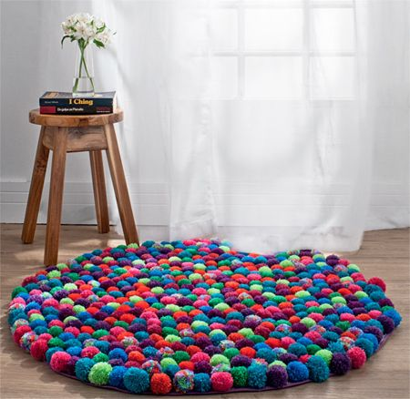 Here's a fun way to inject colour and texture into a room... with a pom-pom rug. Making pom-poms is quick and easy and you can use bought or leftover wool to make a whole bunch of colourful pom-poms - or choose a single colour for your pom-pom rug. http://www.home-dzine.co.za/crafts/craft-pom-pom-rug.htm