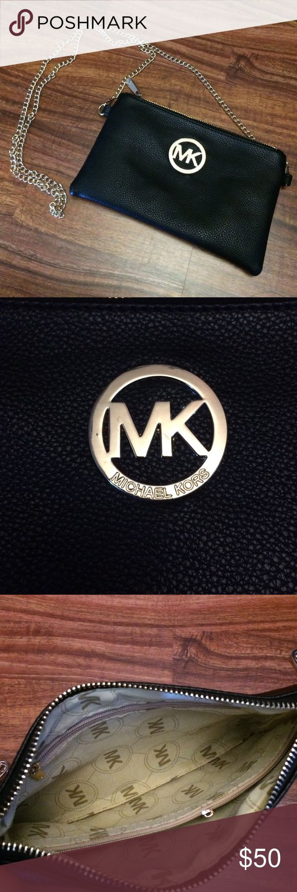 Michael Kors Clutch Michael Kors Clutch. Rarely used. Comes with removable chain strap and wristlet strap. Clean and in excellent condition. Some light scratches on MK emblem. Bags Clutches & Wristlets