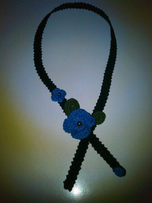 Crochet neck decoration.